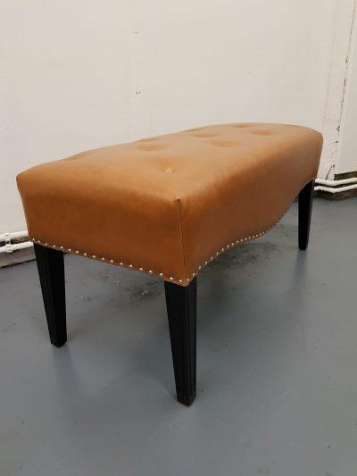 Tan leather footstool